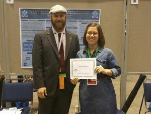 Danielle receiving her award from Caucus Chair, Ben King